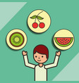 boy cartoon with fruits cherry kiwi strawberry vector image