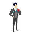 young asian groom holding cup of coffee vector image vector image