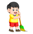 boy with the black hair is sweeping the trash vector image vector image