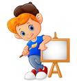 Cartoon boy holding paint brush vector image