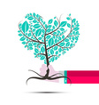 Heart Shaped Tree in Human Hand vector image vector image