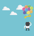 businessmen standing looking at key with balloons vector image