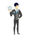 asian groom holding alarm clock vector image vector image