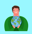 man carefully holds planet earth ecology vector image