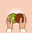 hand holding fresh fruit kiwi vector image