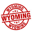 wyoming red round grunge stamp vector image vector image