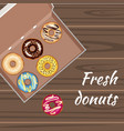 set of colorful glazed donuts in a box vector image
