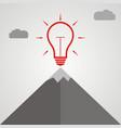 idea light bulb at the top of a mountain vector image vector image