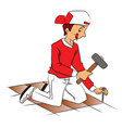 repairman hammering nail to remove tiled floor vector image vector image
