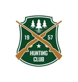 Hunting insignia with crossed rifles on a shield vector image vector image