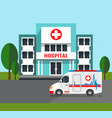 hospital building and ambulance car vector image vector image