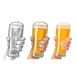 male hand holding a beer glass
