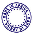 grunge textured made in africa round stamp seal vector image
