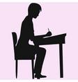 schoolboy sitting at a school desk vector image