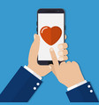 hand holding smartphone heart on the screen vector image