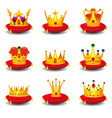 set golden royal crowns on red ceremonial pillow vector image