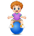 little boy sitting on blue ball vector image