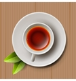 cup black tea top view on cardboard vector image