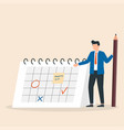manager planning event marking date on calendar vector image