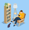 isometric man sitting in a chair at home vector image