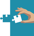 Hand holding piece of puzzle white vector image