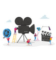 tiny characters making movie operator using vector image vector image
