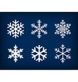white snowflakes on dark blue background vector image vector image