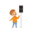 boy pointing finger at pedestrian traffic light vector image vector image