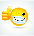 smile winking in medical mask showing thumb up vector image vector image