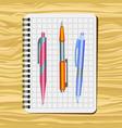 notebook red pen orange pen vector image vector image