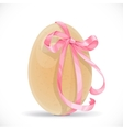 Yellow egg tied with a pink ribbon isolated on a
