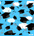 graduation caps in the air graduate background vector image vector image
