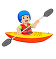 man paddling in a kayak vector image