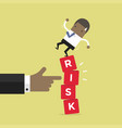african businessman standing on shaky risk blocks vector image vector image