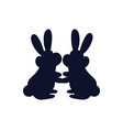 bunnies together silhouette vector image