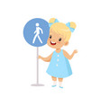 lovely girl standing with pedestrian road sign vector image vector image