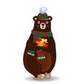Cute autumn bear in green knitted scarf and hat