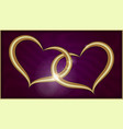 two golden hearts on purple velvet vector image