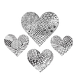 four ornated entangle hearts vector image