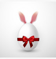 happy easter realistic easter egg with red bow vector image