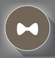 bow tie icon white icon on brown circle vector image