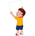 funny boy in yellow shirt holding white black vector image vector image
