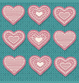 pink heart cookies isolated on knitted background vector image