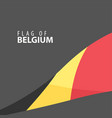 flag of belgium against a dark background vector image vector image