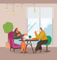 man and woman sitting at table with coffee