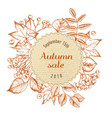 round autumn sale paper emblem over autumn leaves vector image