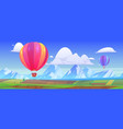 hot air balloons fly above mountain landscape vector image