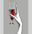 female hand holding a cone glass with red wine vector image vector image