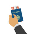 hand holding passport with tickets vector image vector image