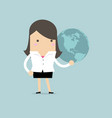businesswoman holding globe in her hand vector image